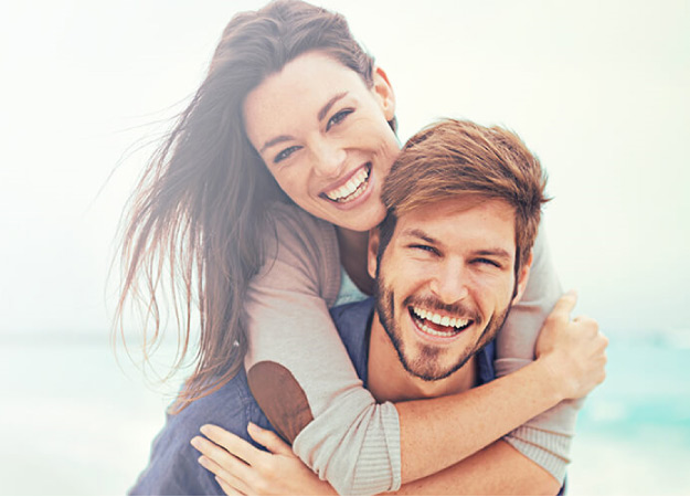 two young adults smile after getting Snap On Smile treatments