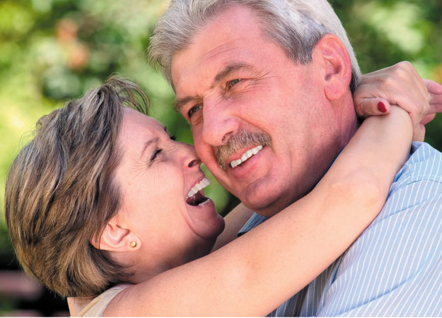 senior couple hugging and laughing after learning about sleep apnea